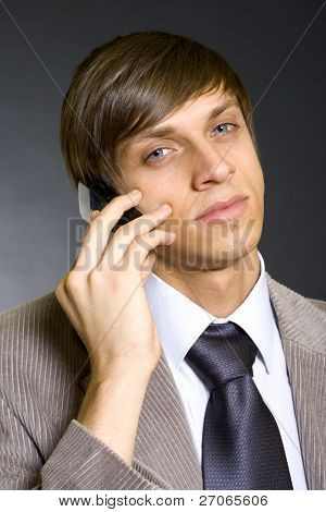 Young businessman calling on mobile phone