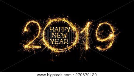 Happy New Year 2019. Golden Fireworks And Text Happy New Year 2019 Written Sparkling Sparklers Isola