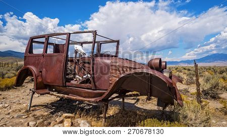 Rusted Antique Car And Cow Skull Sit In The Desert At Great Basin National Park In Eastern Nevada
