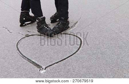 Gay Couple Skating Drew A Heart In The Snow. The Concept Of Same-sex Relationships. Cropped Shot, Sp