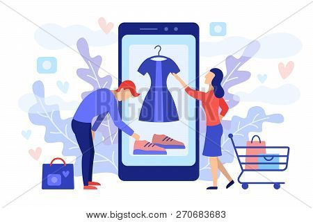 Mobile Shopping Consept. A Man And A Woman Buy Things In The Online Store. Shopping On Social Networ