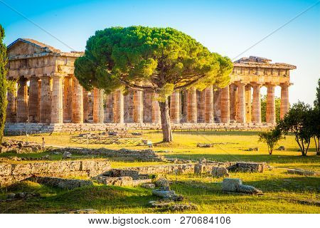 Paestum Temples Archaeological Unesco World Heritage Site At Sunset, Province Of Salerno, Campania,