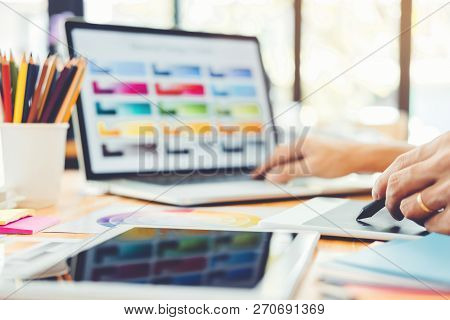 Graphic Designer Brainstorming Drawing On Graphics Tablet At Workplace
