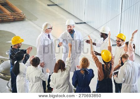 High Angle View At Group Of Factory Workers Protesting Emotionally During Meeting With Management In