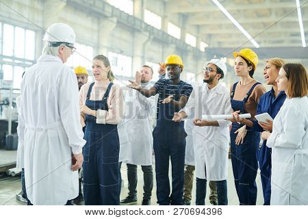 Portrait Of Emotional Young Woman Talking To Mature Manager During Workers Strike On Plant, Copy Spa