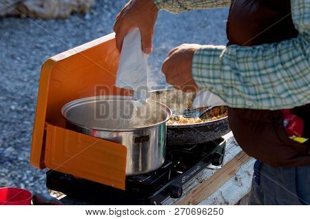 Spring Island, British Columbia, July 23, 2018: Detail Of Camper Pouring A Package Of Instant Mashed