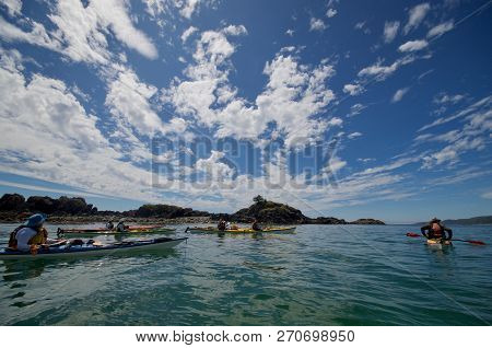 Pacific Ocean Off Of Brookes Peninsula, Vancouver Island, Bc, July 17, 2018: A Group Of Kayakers Pau