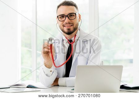 Doctor Showing Stethoscope At Office In Hospital.