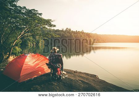 Female Tourists Camping In Beautiful Nature In Tranquil Scene, Tourists Backpack Go To Nature.