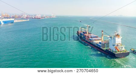 Aerial View Of Cargo Ships In The Sea Are Transported Container To The Port. Import Export And Shipp