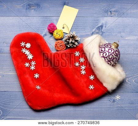 Christmas Sock Toned Wood Background Top View. Fill Sock With Gifts Or Presents. Celebrate Christmas