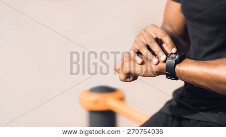 Man Using Black Smart Watch, Checking Heart Rate After Workout Outdoors, Copy Space