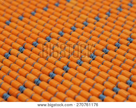 Conveyor Rollers In Orange Close-up Of Rows