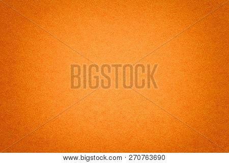Texture Of Vintage Dark Ginger Paper Background With Vignette. Structure Of Dense Orange Kraft Cardb