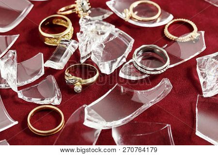 Number Of Gold Rings With Broken Glass On Red Felt