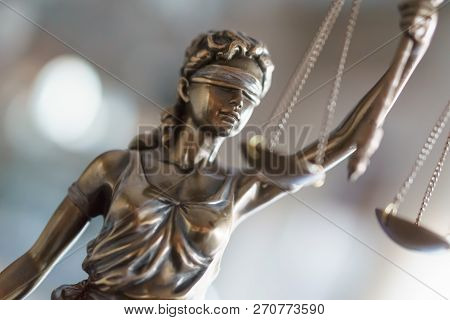 Statue Of Justice With Scales In Lawyer Office.