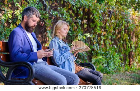 Woman Read Book While Man Read Ebook Smartphone. Man With Beard And Woman Read Alternative Informati