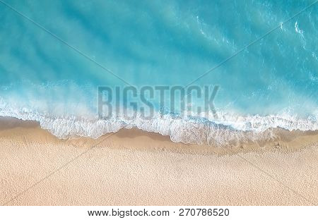 Beach And Waves From Top View. Aerial View Of Luxury Resting At Sunny Day. Summer Seascape From Air.