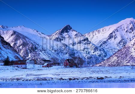 Mountain Ridge And House, Lofoten Islands, Norway. Natural Landscape In The Norway. High Mountain Pe