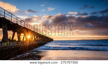 Sunburst On River Blyth Harbour West Pier, As The River Reaches The North Sea Between The Piers In N