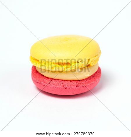 Sweet colorful macaroon isolated on white background.