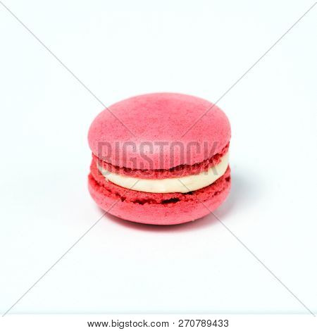 Sweet pink macaroon isolated on white background.