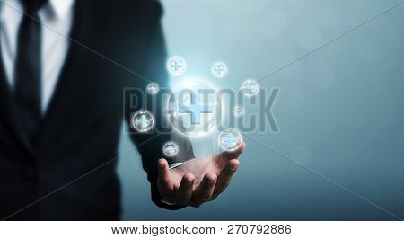 Businessman Hand Holding Bubble Plus Sign Means To Offer Positive Thing (like Benefits, Personal Dev
