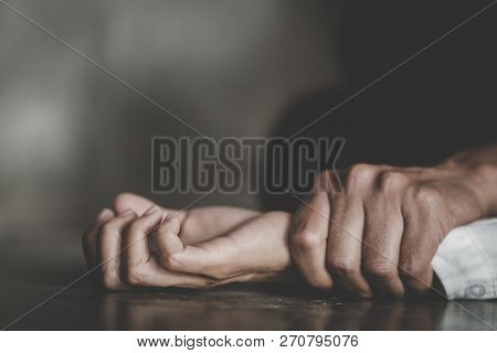 Man's Hand Holding A Woman Hand For Rape And Sexual Abuse Concept, Anti-trafficking And Stopping Vio