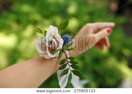 Florist Decorator Hold Bracelet For Bridesmaid Made From Fresh Pink Rose. Wedding Flowers Decoration
