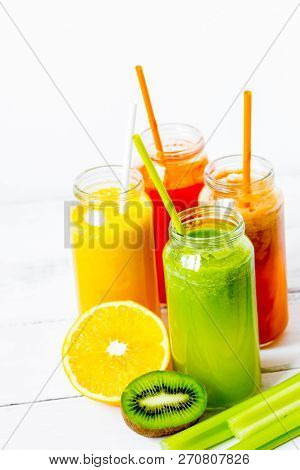 Fresh Detox Juices In Glass Bottles On White Background
