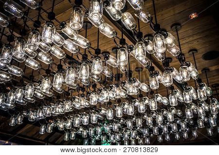 Mason Jar Lights Chandelier Decor At A Restaurant