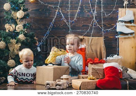 Child New Year. Kids Christmas. Children Playing With Gift. New Years Eve. Christmas Gift Box And Ha