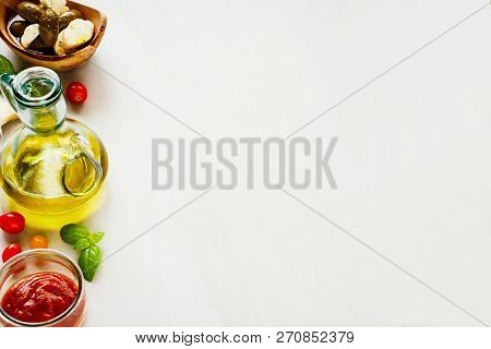 Tomato Sauce, Olives, Mozzarella, Basil Leaves And Oil. Italian Cooking Ingredients.