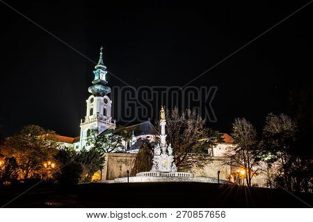Ancient Castle And Plague Column, Nitra, Slovak Republic. Night Scene. Cultural Heritage. Architectu