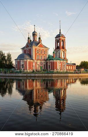 Church Of The Forty Sebastian Martyrs Reflected In Water Of Lake Pleshcheyevo At Sunset, Pereslavl-z