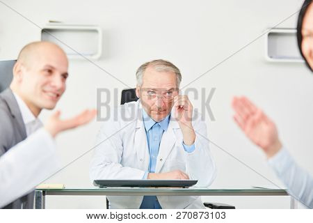 Senior as clinic physician chief executive planning in meeting with staff