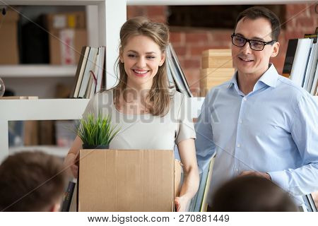 Team Leader Introducing New Hired Female Employee To Colleagues