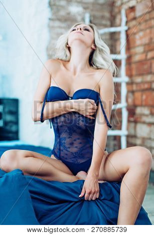 Sexy Beautiful Blonde Woman In Blue Underclothes