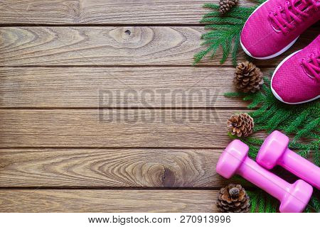 Fitness And Healthy Christmas Sport Composition. Flat Lay Of Sport Shoes, Dumbbells Pine Leaves And
