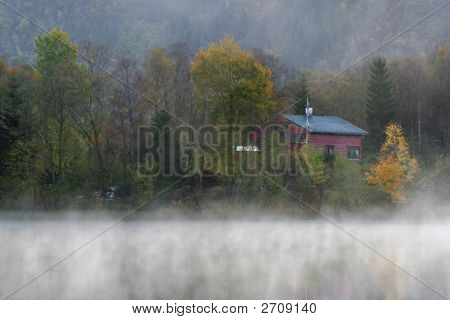 Small Red Wooden House In The Myst