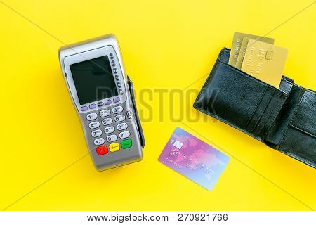 Pay By Bank Card, Pay By Credit Card. Payment Terminal Near Card And Wallet With Bank And Credit Car