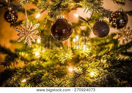 Christmas Background Of De-focused Lights Decorated Tree Illuminated Moody