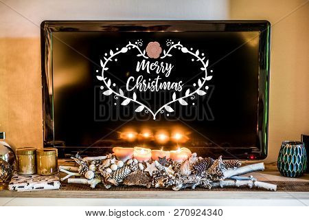 Four Burning Advent Candles, Beautiful Decorated Setup Light Tv In Background Textspace Saying Merry