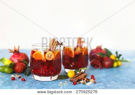 Sangria Pomegranate, Pear, Orange, Kumquat And Spices, Cinnamon, Cloves, Star Anise.