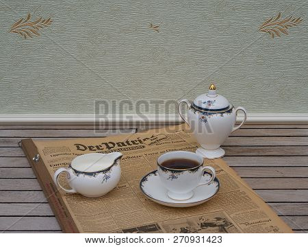 A Part Of An English Tea Set On An Old German Daily Newspaper Der Patriot, Edition From 8. June 1950