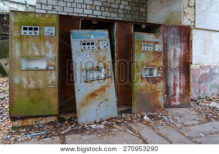 Pripyat, Ukraine - November 11, 2018: Rusty Vending Machines For Sale Soda Water Near Cafe In Dead A