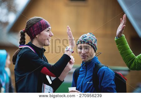 Czech Republic, Pilsen, November 2018: Hannah Pilsen Trail Krkavec. The Friends Giving High Five At
