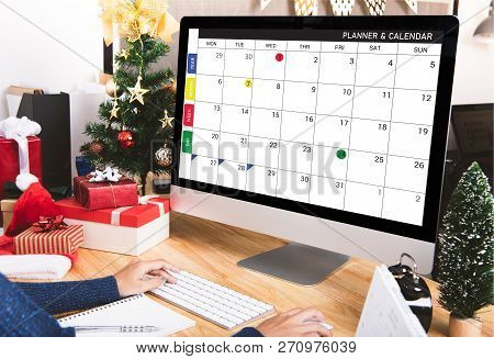 Businesswoman With Calendar Planner On Computer Screen In Christmas Holiday At The Office With Chris