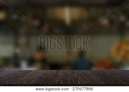People Cooking Food In Restaurant Kitchen. Blur Background