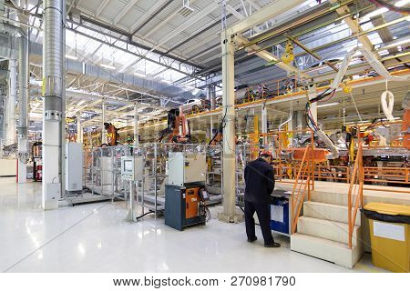 Workers Assemble A Vehicle Body. Process Of Welding Cars. Modern Assembly Of Cars At The Plant. Auto